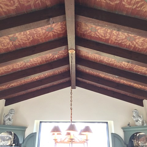 Spanish-Stylle-decorative-ornament-stenciling-on-ceiling-beams-in-dining-room