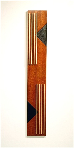 A wooden sculptural wall hanging of Jatoba, ebonized Walnut, Maple and metal