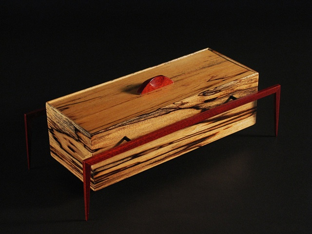 Wish Box is a unique sculptural wooden vessel of spalted Poplar, Bloodwood and metal.
