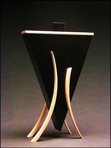 Dark Vessel is a unique sculptural wooden vessel of ebonized Walnut. Maple and metal.