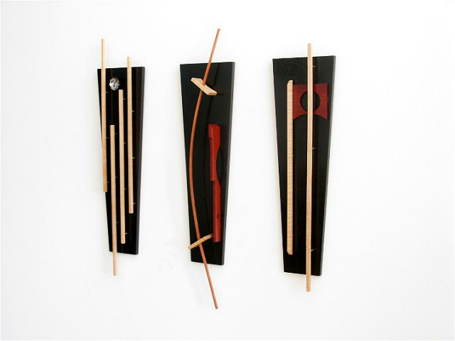 A wooden 3 piece sculptural wall hanging of various woods