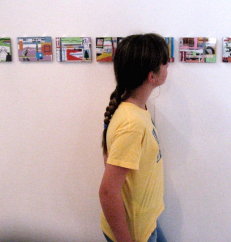 young patron looking at collages.
