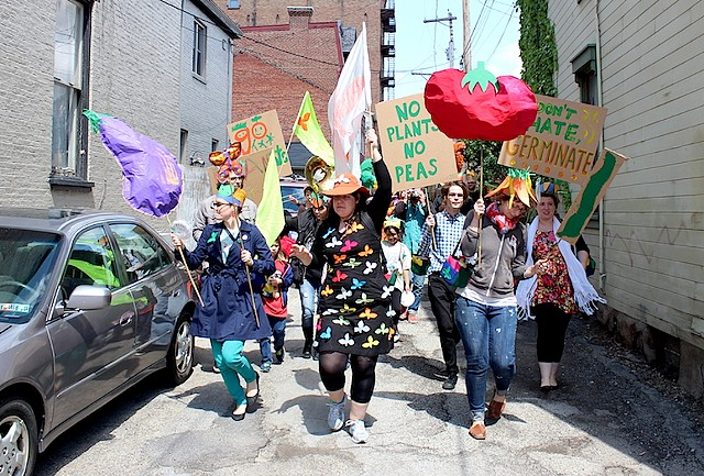 plants, backpacks, people, performance art, parade