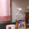 Still Life with Dirty Dishes and Pink Curtains