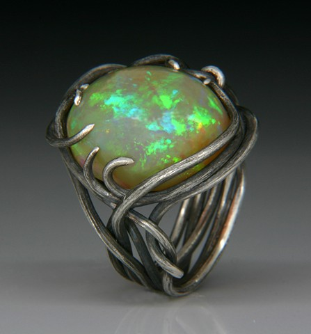 Custom silver hand fabrincated ring with Ethiopian Opal