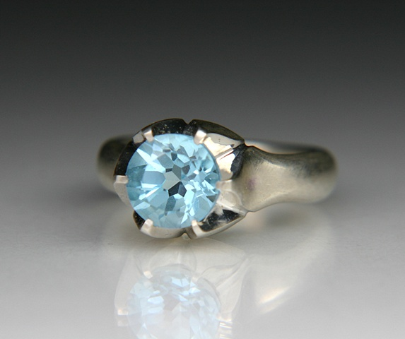 Lotus ring in silver set with a 9mm Sky Blue Topaz