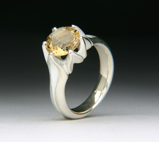 THE FULL LOTUS IS A DESIGN TWIST ON THE LOTUS RING. THE MOUTNING IS DE-OX SILVER THAT DOESN'T TARNISH LIKE STERLING SILVER. SET WITH AN AMAZING UNTREATED NATURAL YELLOW CITRINE.