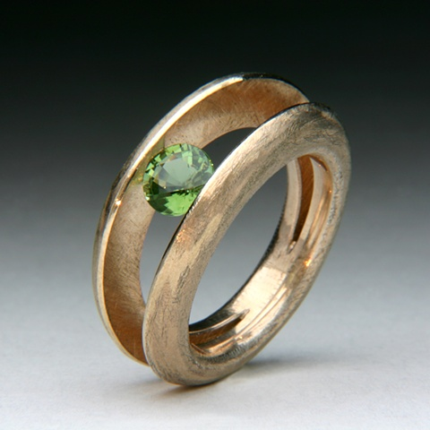 Tension set Green Tourmaline set in a Custom Alloy Ring