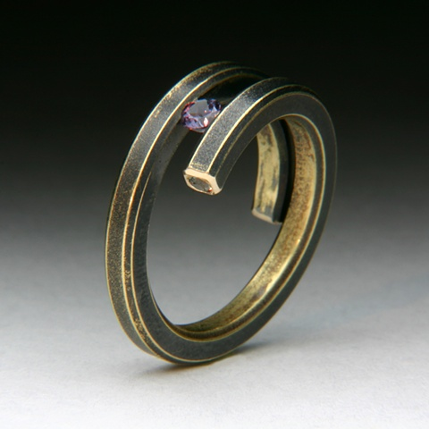 Bi-Pass Coil 14 karat yellow Gold Ring tension set with a color change Garnet