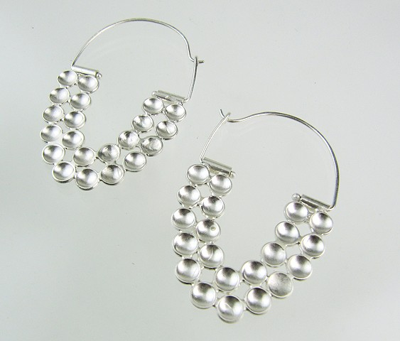 Superstition hoop earrings