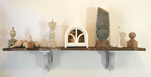 Arrangement of wooden remnants from various projects on found pine shelf, hung up with handmade corbel brackets.
