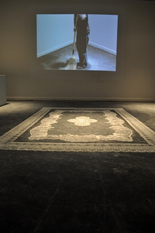 Lisa Demagall, art, dust, installation, lace, rug, trodden, sculpture, ephemera, floor, threshold, stencil, domestic, video, sweeping, broom