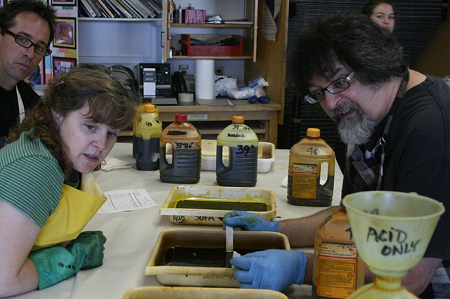 Dave, Nancy and Mark keeping time during etching process