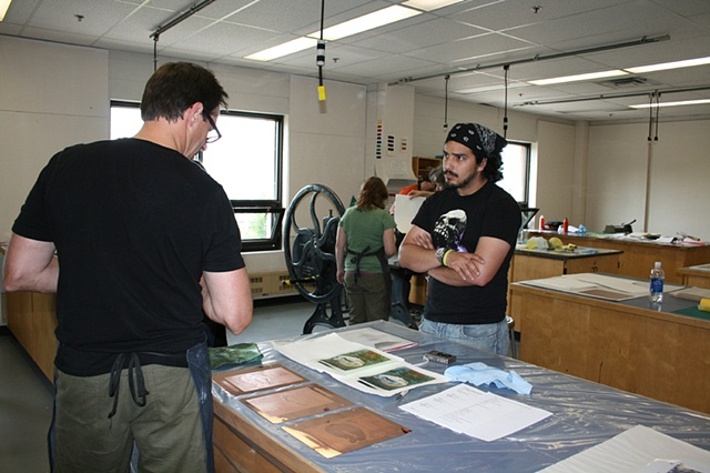 Mark Bovey speaking with a visual arts student