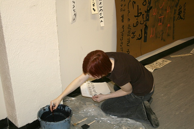 Shawna Warmington drawing with a bucket of ink!