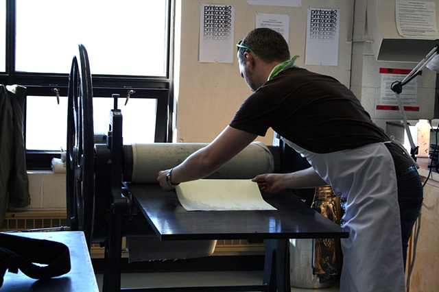 Mark Adams printing on the etching press