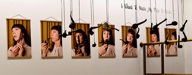 I Want To Have My Pipe & Smoke It  Installation view of 18 selfies with pipe in ArtSpace at Arti et Amicitiae, Amsterdam, The Netherlands
