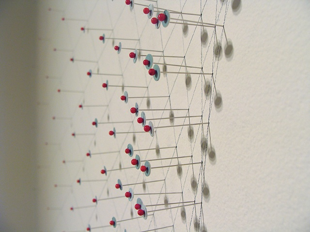 Installation using maps and pins for the show titled Maps at June Fitzpatrick Gallery by Shannon Rankin