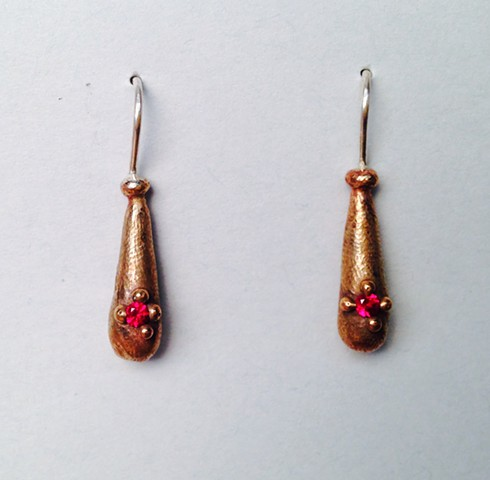 Bronze Droplets with Red Stones