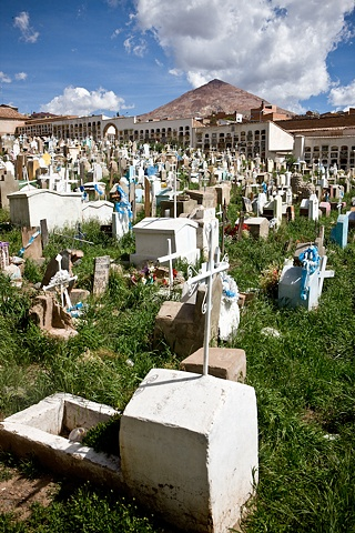 Section of the cemetery in Potosi where the poorest people (mostly miners) are buried; the burial site is paid annually, if the family stops paying, the boy is exhumed to give site for another body. Cerro Rico can be seen in the foreground.