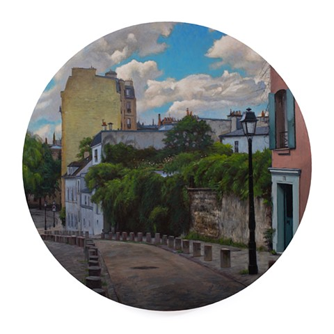 'Down Rue de l'Abreuvoir' is a realistic landscape painting by 'Kyle Andrew Phillips'. It is 20 inches in diameter done in oil on a wood panel tondo.