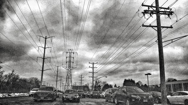 Parking, Power Lines, and Storm Clouds