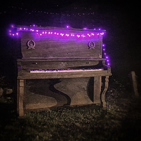 piano with purple lights at night