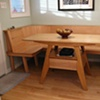 Maple wood kitchen table and built-in bench seating