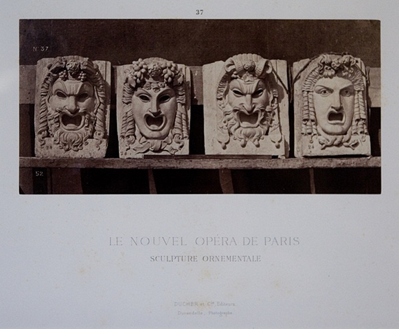 "FOUR ORNAMENTAL STONE MASKS FOR THE ""NEW"" PARIS OPERA, 1872"