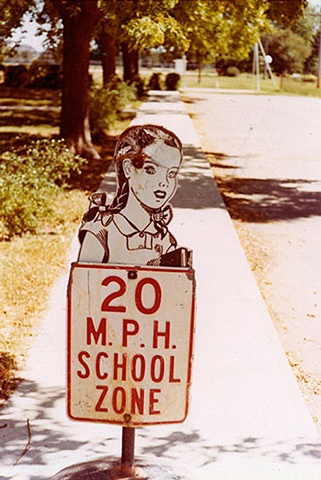 UNTITLED (CHILD AS SCHOOL SIGN)