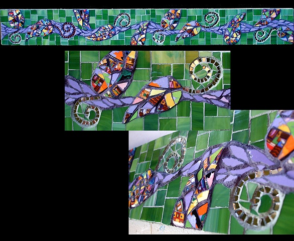 Glass and china mosaic backsplash with mirror accents and leaf motif. purple, green, pique assiette.