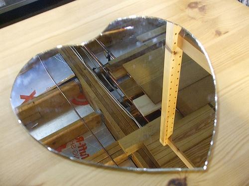 Salvaged mirror hand cut into heart shape