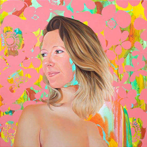 Portrait of a blonde, lesbian woman with an abstract background and pink floral pattern.