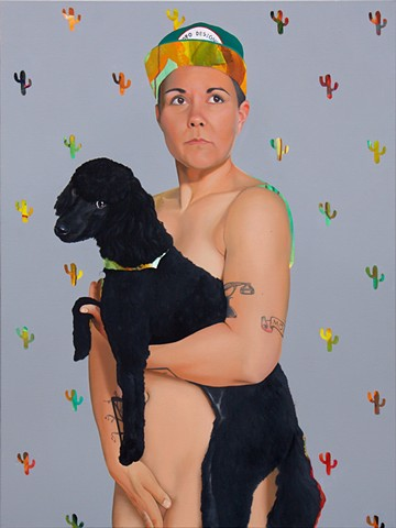 Portrait of a nude lesbian holding her dog in front of a grey cactus-pattern background.