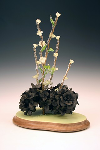 resin dipped silk flower and black clay sculpture