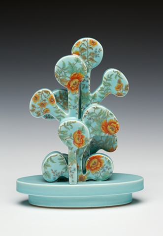 Blue and orange porcelain tree sculpture with vintage decals