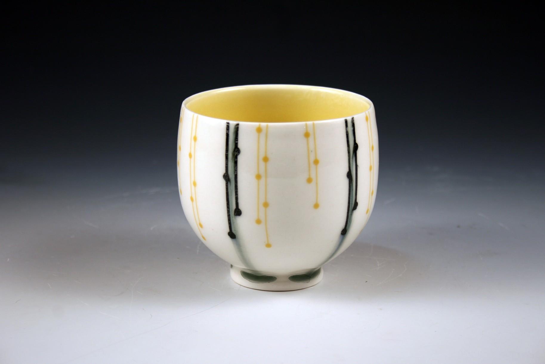 Porcelain slip cast cups with underglaze and overglaze decals